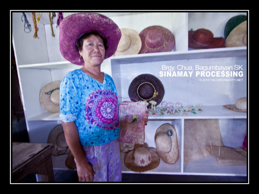 Mrs. Bogador holding one of their products on sale at their processing plant in Brgy. Chua